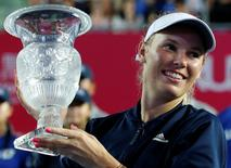 Tennis - Hong Kong Open final - Caroline Wozniacki of Denmark v Kristina Mladenovic of France - Hong Kong, China - 16/10/16. Wozniacki celebrates with trophy.   REUTERS/Bobby Yip