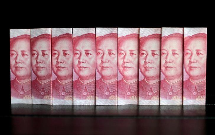 Chinese 100 yuan banknotes are seen in this picture illustration taken July 11, 2013. REUTERS/Jason Lee/File Photo