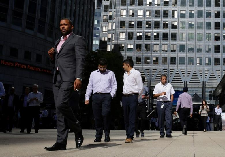 People walk through the Canary Wharf, the business and financial district in London, Britain, September 8, 2016. REUTERS/Kevin Coombs/File Photo