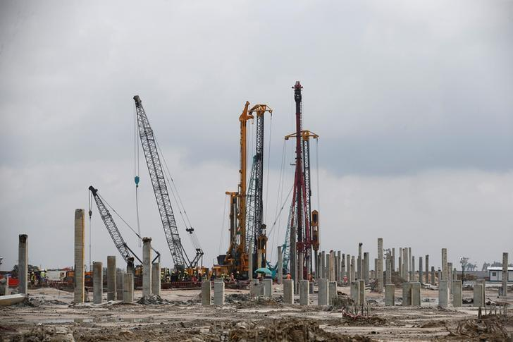 Cranes are seen during a facility tour at the proposed Dangote oil refinery site near Akodo beach in the outskirt of Nigeria's commercial capital Lagos June 25, 2016. REUTERS/Akintunde Akinleye/Files