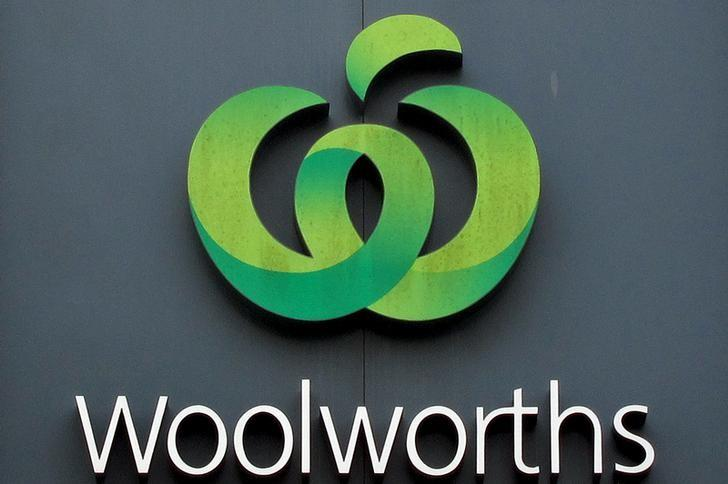 A Woolworths logo is displayed above one of the company's supermarkets in Sydney, Australia, February 26, 2016. REUTERS/David Gray