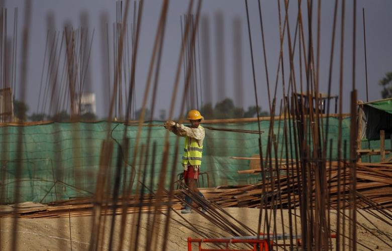 A man works at the site of the Thilawa Special Economic Zone (SEZ) project at Thilawa May 8, 2015.       REUTERS/Soe Zeya Tun/File Photo