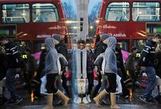 Shoppers are reflected in a shop window as they walk along Oxford Street on the last Saturday before Christmas, in London  December 21, 2013.   REUTERS/Luke MacGregor/File Photo                   GLOBAL BUSINESS WEEK AHEAD PACKAGE    SEARCH BUSINESS WEEK AHEAD 17 OCT FOR ALL IMAGES - RTX2P3C2