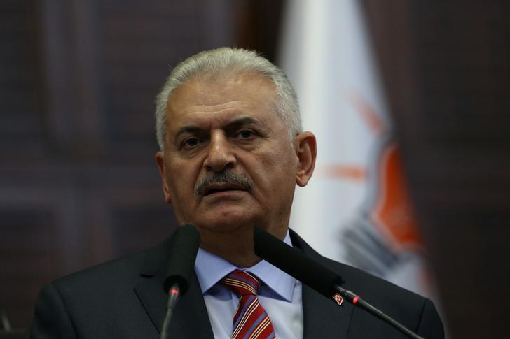 Turkey's Prime Minister Binali Yildirim addresses members of parliament from his ruling AK Party (AKP) during a meeting at the Turkish parliament in Ankara, Turkey, August 2, 2016. Hakan Goktepe/Prime Minister's Press Office/Handout via REUTERS/Files