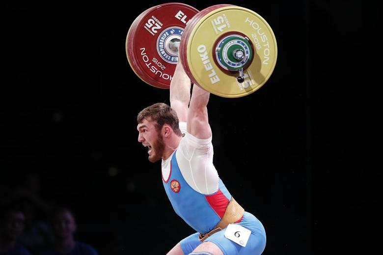 Nov 25, 2015; Houston, TX, USA;  Overall bronze medalist winner  Apti Aukhadov from Russia competes in the men's 85kg group A  during the International Weightlifting Federation World Championships at George R. Brown Convention Center. Mandatory Credit: Thomas B. Shea-USA TODAY Sports