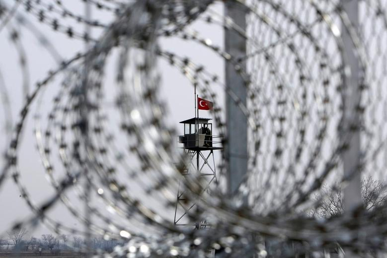 A Turkish military watchtower is seen through the barbed wire of a fence in Orestiada, Greece, February 6, 2012.   REUTERS/Vassilis Ververidis/Motion Team/File Photo