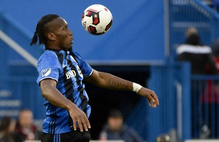 Jun 8, 2016; Montreal, Ontario, Canada; Montreal Impact forward Didier Drogba (11) plays the ball during the first half against the Toronto FC at Stade Saputo. Mandatory Credit: Eric Bolte-USA TODAY Sports