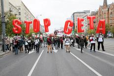 People march to protest against the planned CETA free trade agreement (Comprehensive Economic and Trade Agreement) between the European Union and Canada, and similar plans between EU and United States (TTIP) in Warsaw, Poland October 15, 2016. Agencja Gazeta/Kuba Atys/via REUTERS