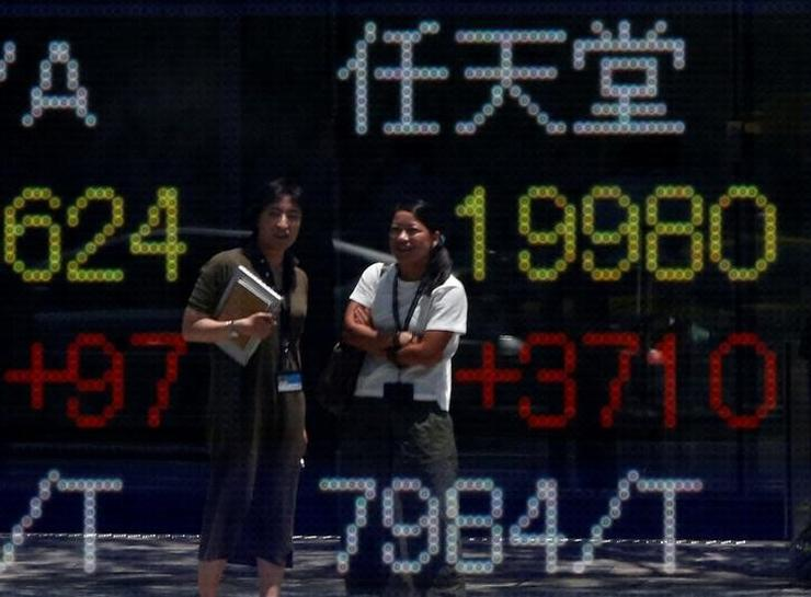 Asian shares manage muted cheer for China growth | Reuters