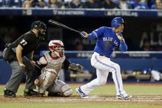 Toronto Blue Jays right fielder Ezequiel Carrera (3) hits a triple during the eighth inning against the Cleveland Indians in game four of the 2016 ALCS playoff baseball series at Rogers Centre. Mandatory Credit: John E. Sokolowski-USA TODAY Sports