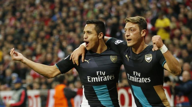 Football - Bayern Munich v Arsenal - UEFA Champions League Group Stage - Group F - Allianz Arena, Munich, Germany - 4/11/15Arsenal's Mesut Ozil celebrates with Alexis Sanchez after scoring a goal but it is later disallowedAction Images via Reuters / John Sibley