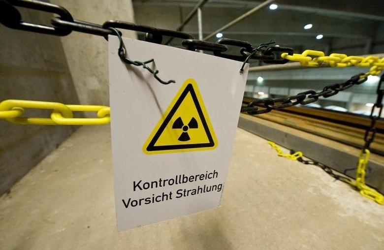 A warning sign for radioactive materials is seen in the warehouse for 'Castor' containers at 'Zwischenlager Gorleben' temporary nuclear waste storage facility in the northern German village of Gorleben near Dannenberg August 5, 2010.   REUTERS/Morris Mac Matzen