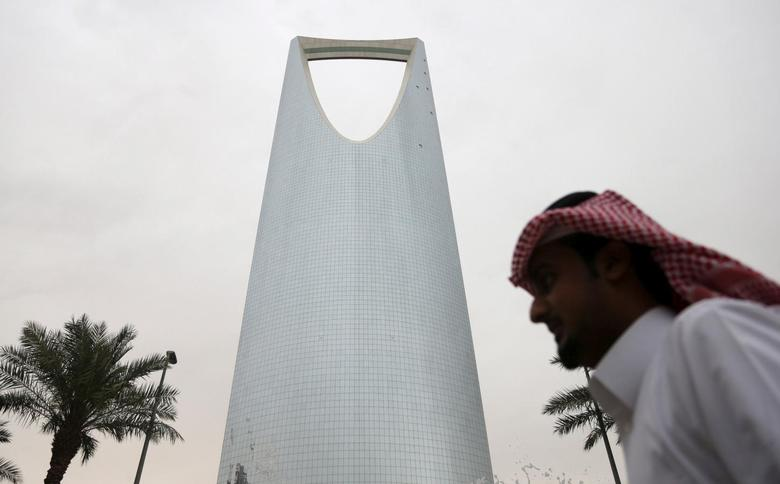 A man walks past the Kingdom Centre Tower in Riyadh, Saudi Arabia April 12, 2016. REUTERS/Faisal Al Nasser/File Photo