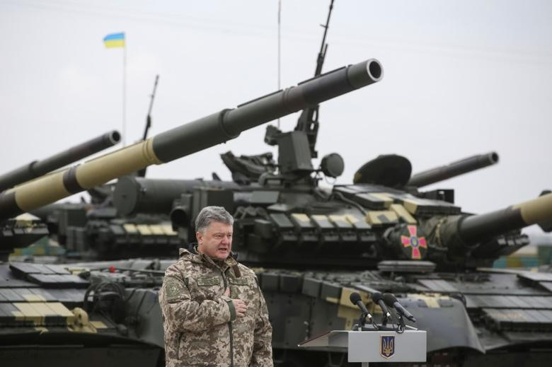 Ukrainian President Petro Poroshenko attends a ceremony to hand over weapons and military vehicles to servicemen of the Ukrainian armed forces in Chuhuiv outside Kharkiv, Ukraine, October 15, 2016. Mikhail Palinchak/Ukrainian Presidential Press Service/Pool via REUTERS ATTENTION EDITORS - THIS IMAGE WAS PROVIDED BY A THIRD PARTY. EDITORIAL USE ONLY.     TPX IMAGES OF THE DAY