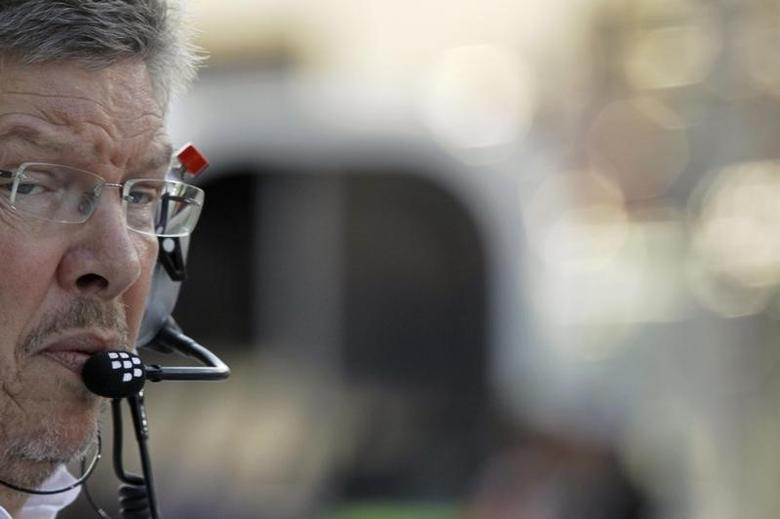 Mercedes Team Principal Ross Brawn crosses the pit lane just before the start of the qualifying session of the Abu Dhabi F1 Grand Prix at the Yas Marina circuit on Yas Island, November 2, 2013. REUTERS/Caren Firouz