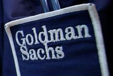 The logo of Dow Jones Industrial Average stock market index listed company Goldman Sachs (GS) is seen on the clothing of a trader working at the Goldman Sachs stall on the floor of the New York Stock Exchange, United States, in this April 16, 2012 file photo. REUTERS/Brendan McDermid/File Photo