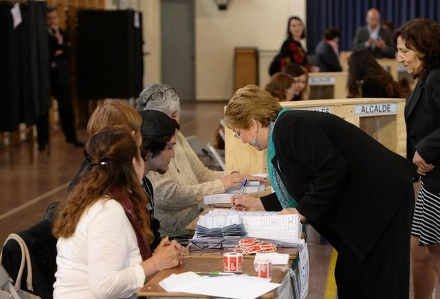 Chile's President Michelle Bachelet attends to vote during the mayors and councillors elections in Santiago, Chile, October 23, 2016. Alex Ibanez/Courtesy of Chilean Presidency/Handout via Reuters