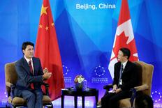 Canada's Prime Minister Justin Trudeau (L) and Chairman and chief executive of Alibaba Group Jack Ma attend the China Entrepreneur Club Leaders Forum in Beijing, China, August 30, 2016. REUTERS/Jason Lee/File Photo