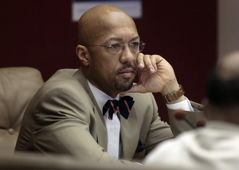 Detroit City Council president Charles Pugh listens to a council member speak during a City Council meeting in Detroit, Michigan January 20, 2012.   REUTERS/Rebecca Cook