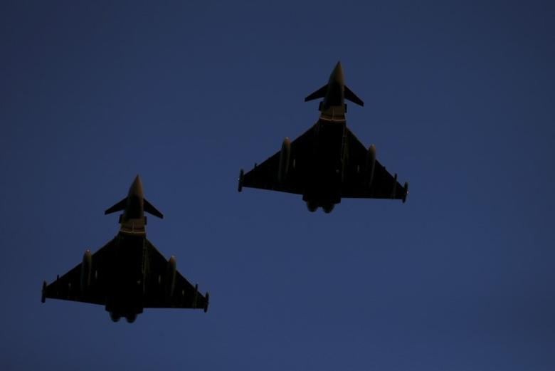RAF Typhoons fly above RAF Lossiemouth in Scotland, December 2, 2015. REUTERS/Russell Cheyne