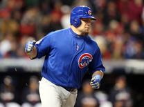 Oct 26, 2016; Cleveland, OH, USA; Chicago Cubs player Kyle Schwarber hits  a RBI single against the Cleveland Indians in the 5th inning in game two of the 2016 World Series at Progressive Field. Mandatory Credit: Charles LeClaire-USA TODAY Sports