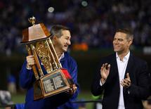 Chicago Cubs owner Tom Ricketts raises the National League Championship Trophy after game six of the 2016 NLCS playoff baseball series at Wrigley Field, in Chicago, Illinois, U.S., October 22, 2016. At right is President of Baseball operations Theo Epstein. Mandatory Credit: Jerry Lai-USA TODAY Sports/File Photo