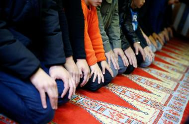 Muslims pray during Friday prayers at the Cuba Camii mosque in Cologne