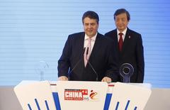 German Vice Chancellor Sigmar Gabriel and China's Vice Premier Ma Kai (R) address the media prior to touring the CeBIT trade fair in Hanover March 16, 2015. REUTERS/Morris Mac Matzen/Files