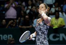 Tennis - Singapore WTA Finals Round Robin Singles - Singapore Indoor Stadium, Singapore - 28/10/2016 - Agnieszka Radwanska of Poland celebrates after defeating Karolina Pliskova of the Czech Republic   REUTERS/Edgar Su