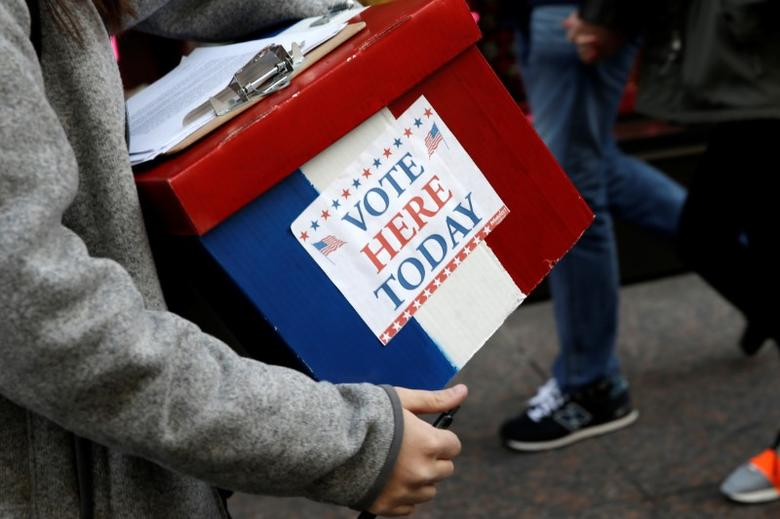An election volunteer holds a box outside Trump Tower in the Manhattan borough of New York City, October 26, 2016. REUTERS/Mike Segar