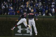 Oct 29, 2016; Chicago, IL, USA; Cleveland Indians shortstop Francisco Lindor (12) celebrates with right fielder Lonnie Chisenhall (right) after game four of the 2016 World Series against the Chicago Cubs at Wrigley Field. The Indians defeated the Cubs 7-2. Mandatory Credit: Jerry Lai-USA TODAY Sports
