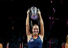 Tennis - Singapore WTA Finals Singles Finals - Singapore Indoor Stadium, Singapore - 30/10/2016 - Dominika Cibulkova of Slovakia celebrates with her trophy after defeating Angelique Kerber of Germany. REUTERS/Edgar Su