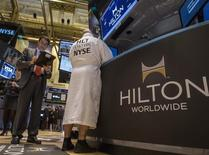 FILE PHOTO - Specialist Trader John O'Hara (R) wears a Hilton branded bathrobe to celebrate Hilton's IPO, while working at his post on the floor of the New York Stock Exchange, December 13, 2013. REUTERS/Brendan McDermid