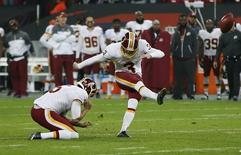 Britain American Football - Cincinnati Bengals v Washington Redskins - NFL International Series - Wembley Stadium, London, England - 30/10/16 Washington Redskins' Dustin Hopkins misses a kick in over time Action Images via Reuters / Paul Childs Livepic EDITORIAL USE ONLY.