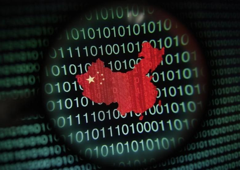 A map of China is seen through a magnifying glass on a computer screen showing binary digits in Singapore in this January 2, 2014 photo illustration.  REUTERS/Edgar Su