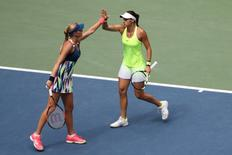 Sep 11, 2016; New York, NY, USA; Caroline Garcia and Kristina Mladenovic of France celebrate a game won against Bethanie Mattek-Sands of the United States and Lucie Safarova of the Czech Republic in the championship match on day fourteen of the 2016 U.S. Open tennis tournament at USTA Billie Jean King National Tennis Center. Mandatory Credit: Anthony Gruppuso-USA TODAY Sports