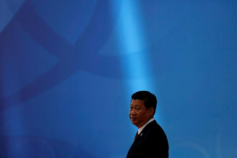 Chinese President Xi Jinping waits for leaders to arrive before the opening ceremony in the Expo Center at the fourth Conference on Interaction and Confidence Building Measures in Asia (CICA) summit in Shanghai May 21, 2014. REUTERS/Aly Song/File Photo