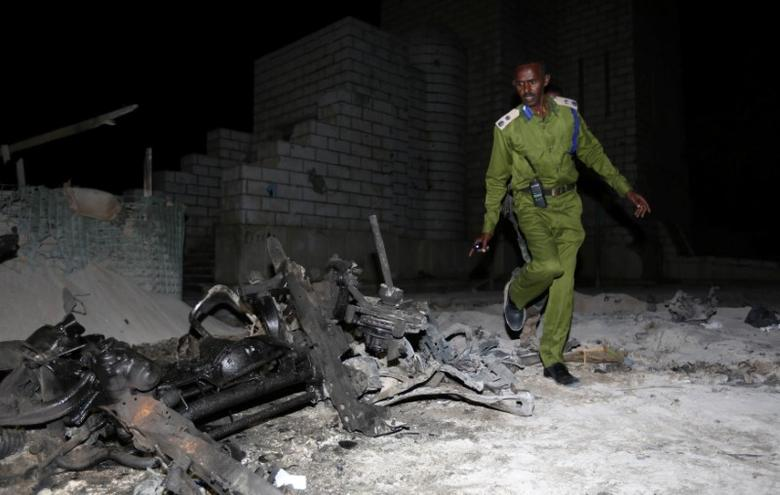 A Somali policeman inspects the scene of a suicide car explosion near the parliament in the capital Mogadishu, November 5, 2016. REUTERS/Feisal Omar
