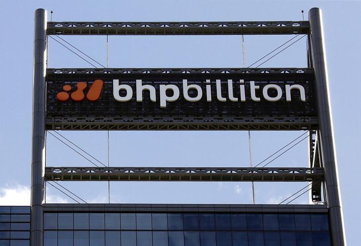 A sign adorns the building where mining company BHP Billiton has their office in Perth, Western Australia, November 19, 2015. REUTERS/David Gray/File photo