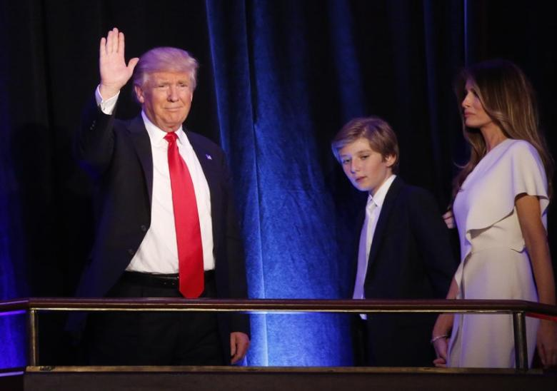 U.S. Republican presidential nominee Donald Trump arrives to speak at his election night rally with his son Barron and wife Melania in Manhattan, New York, U.S., November 9, 2016.       REUTERS/Carlo Allegri
