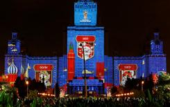 A lighting installation showing a cat, a tiger and a wolf - candidates for the official mascot of the 2018 FIFA World Cup is seen during a presentation on the facade of Moscow State University, part of the Circle of Light International Festival in Moscow, Russia September 23, 2016. REUTERS/Sergei Karpukhin