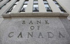 The Bank of Canada building is pictured in Ottawa July 19, 2011. The Bank of Canada held its key interest rate steady on Tuesday as expected but hinted more strongly than before that it would resume hiking soon as the sturdy domestic economy grows closer to full capacity.       REUTERS/Chris Wattie