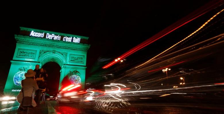 The Arc de Triomphe is illuminated in green with the words ''Paris Agreement is Done'', to celebrate the Paris U.N. COP21 Climate Change agreement in Paris, France, November 4, 2016. REUTERS/Jacky Naegelen