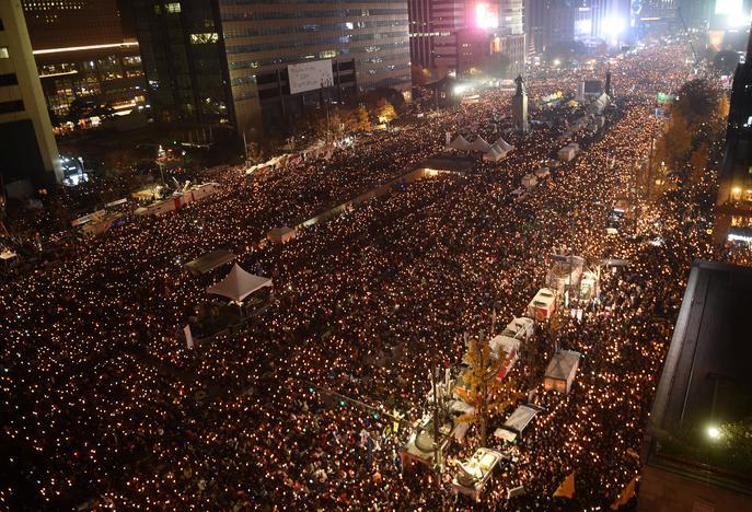 Thousands protest South Korean president as older conservatives