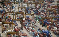 Containers are stacked up at PSA's Tanjong Pagar container terminal in Singapore July 24, 2015.    REUTERS/Edgar Su/File Photo