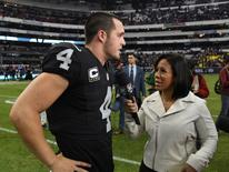 Nov 21, 2016; Mexico City, MEX; ESPN Monday Night Football sideline reporter Lisa Salters (right) interviews Oakland Raiders quarterback Derek Carr (4) after a NFL International Series game against the Houston Texans at Estadio Azteca. The Raiders defeated the Texans 27-20. Mandatory Credit: Kirby Lee-USA TODAY Sports