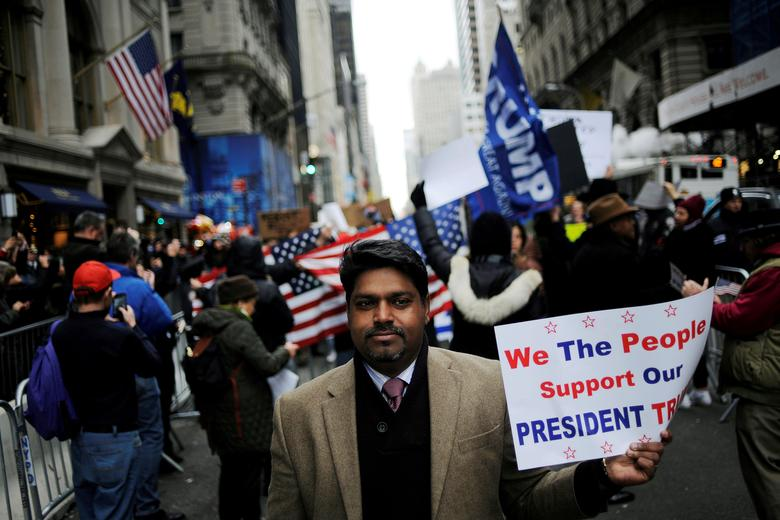 A supporter of U.S. President-elect Donald Trump walks away from a protest near Trump Tower in the Manhattan borough of New York, U.S. November 20, 2016. REUTERS/Mark Kauzlarich