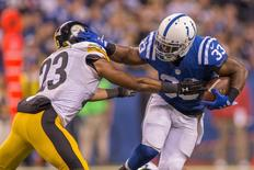 Nov 24, 2016; Indianapolis, IN, USA; Indianapolis Colts running back Robert Turbin (33) runs the ball while Pittsburgh Steelers free safety Mike Mitchell (23) defends in the second half of the game at Lucas Oil Stadium.  Mandatory Credit: Trevor Ruszkowski-USA TODAY Sports