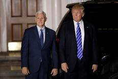 U.S. President-elect Donald Trump and Vice President-elect Mike Pence depart the main clubhouse at Trump National Golf Club in Bedminster, New Jersey, U.S., November 19, 2016.  REUTERS/Mike Segar