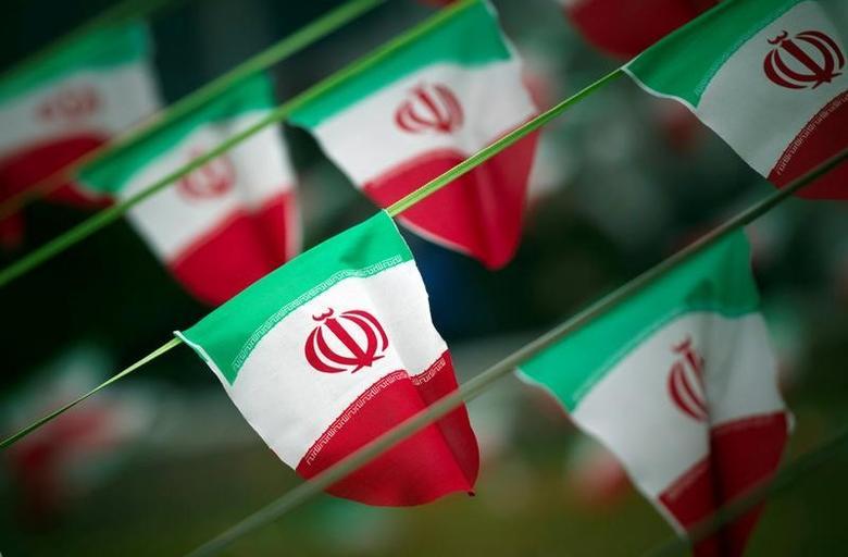 Iran's national flags are seen on a square in Tehran February 10, 2012. REUTERS/Morteza Nikoubazl/File Photo